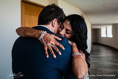 Indian Bride Hugging groom