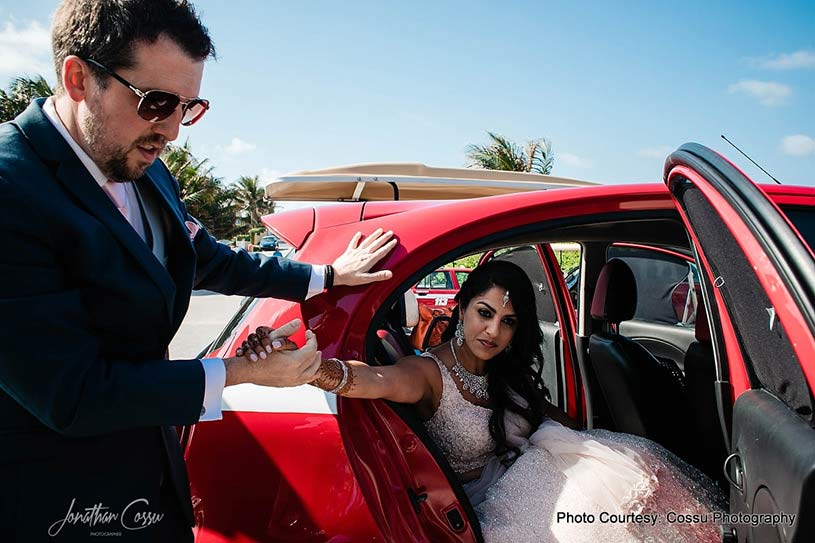 Groom taking Indian Bride out of the car