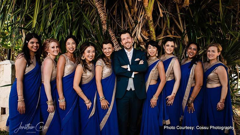 Groom Posing with Bridesmaids