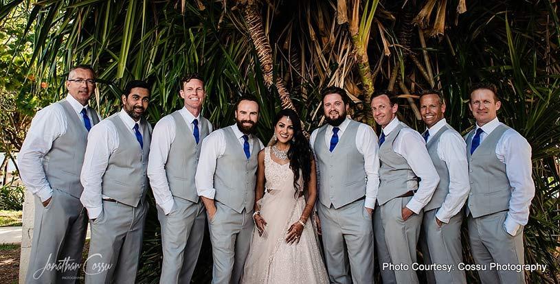 Indian Bride posing with Groomsmen