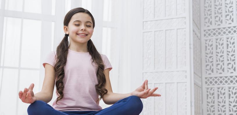 Happy Child doing Meditation
