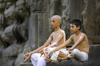 Indian priest childs doing yoga park