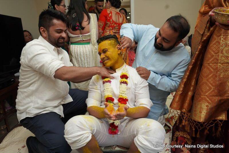 Groomsmen applying haldi to Indian Groom India Wedding Ritual