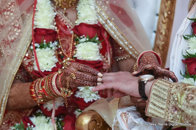 Bride going to put ring to groom's finger