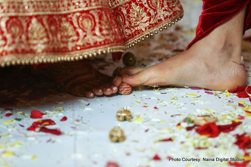 Indian Couple putting toes on sopari