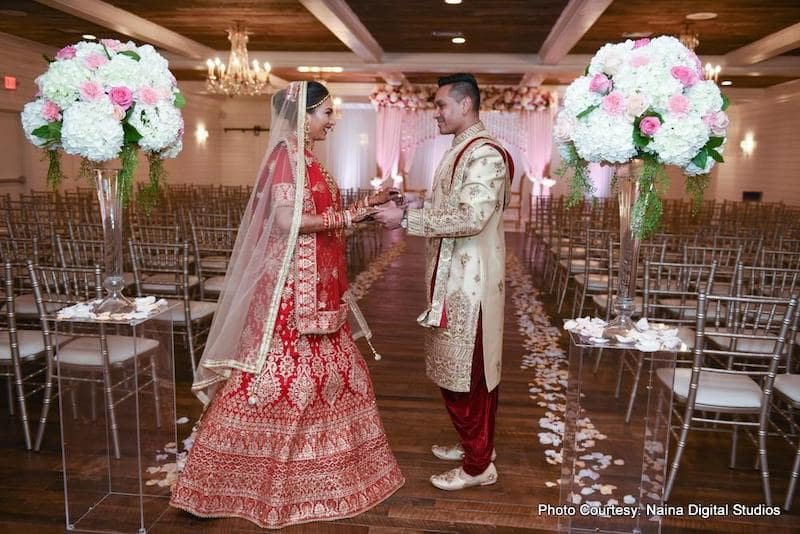Indian Wedding couple holding each other's hands