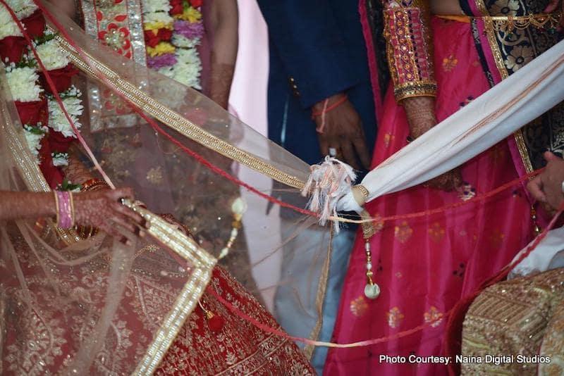 Gath Bandhan - tied Indian Bride and Groom's Chunri