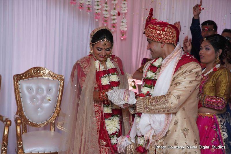 Indian Bride and Groom under wedding Mandap