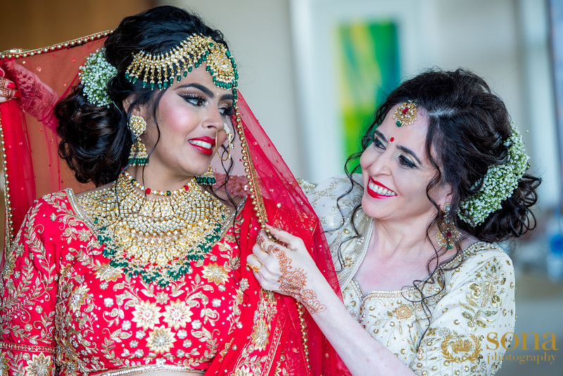 Bride's Mother with Bride posing for picture