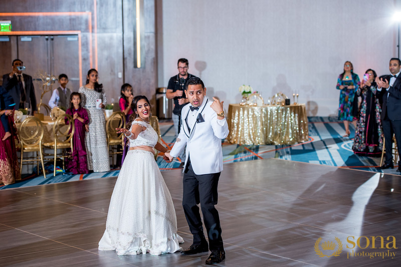 Indian couple dancing at reception